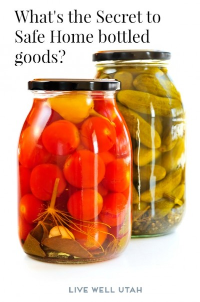 Two clear glass jars of colorful pickled vegetables